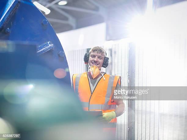 Worker in metal ore grinding mill