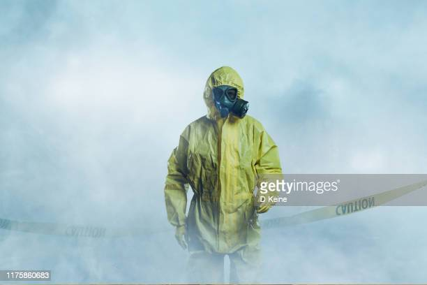 worker in protective suit - epidemic stock pictures, royalty-free photos & images