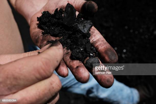 A worker in the coal industry handles coal at a coal prep plant on May 19 2017 outside the city of Welch West Virginia West Virginia a state where...
