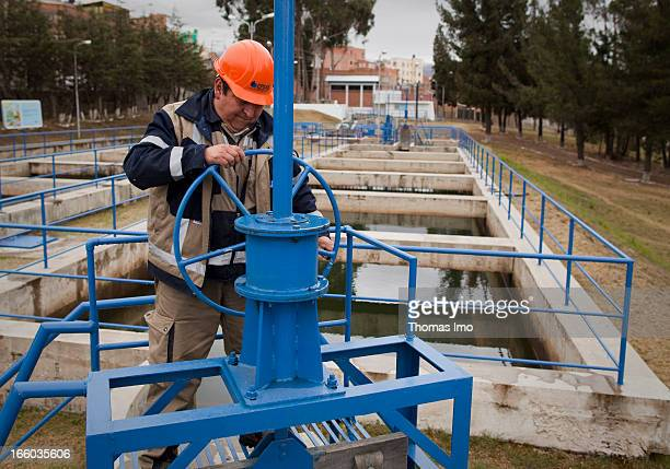 A worker in the drinking water treatment plant of Pampahasi in charge of La Paz and El Alto