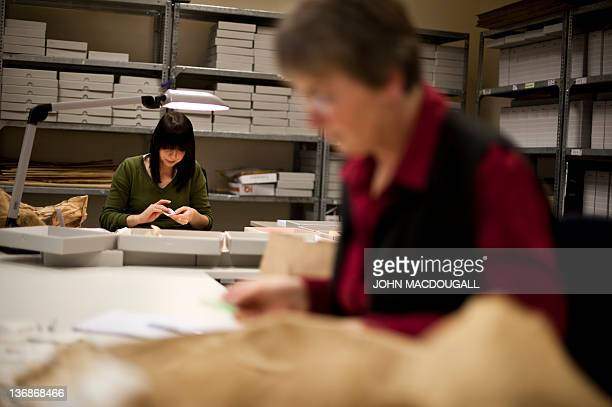 A worker in the former headquarters of the Stasi sorts through hundreds of thousands of torn or shredded Stasi documents earmarked for destruction...