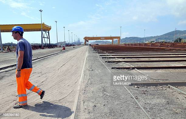 A worker in the Lucchini steelworks on August 5 2010 in Piombino Italy Alexei Mordashov the Russian billionaire chief executive officer of OAO...