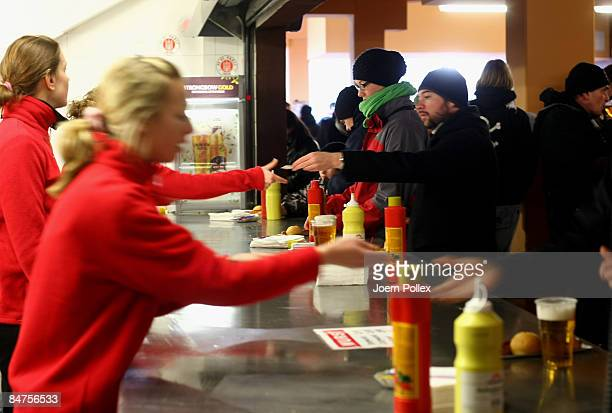 Worker in the Millerntor Stadium sell sausages and beer prior to the 2 Bundesliga match between FC St Pauli and SpVgg Greuther Fuerthg at the...