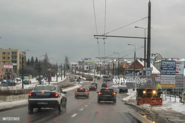 Worker in the old Polish URSUS tractor snowclearing sidewalk is seen in Gdynia Poland on 19 January 2018 Heavy snow fall and wind Power has been cut...