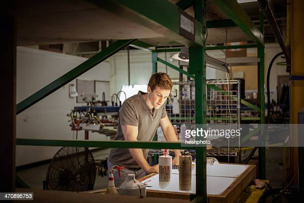 worker in warehouse, looking at paperwork - heshphoto stock pictures, royalty-free photos & images