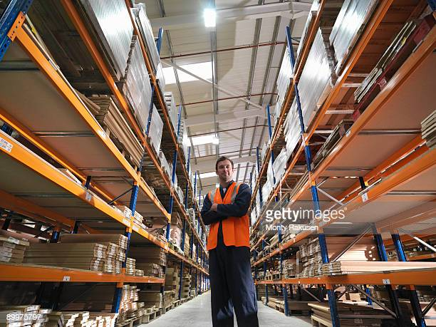 worker in warehouse - monty rakusen stock pictures, royalty-free photos & images