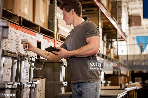 worker in warehouse scanning barcode on cardboard box - heshphoto stock pictures, royalty-free photos & images
