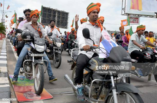 BJYM worker inadvertently crushes a hoarding of BJP President Amit Shah under the wheels of his motorcycle while leading the cavalcade from airport...