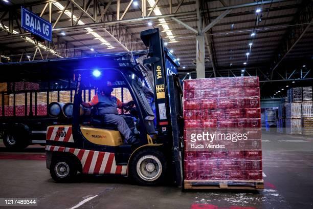 Worker inside of Ambev's Barra do Pirai Brewery on March 31, 2020 in Barra do Pirai, Brazil. Ambev is producing hand sanitizers using ethanol...
