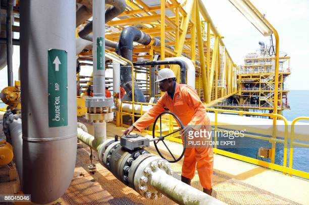 A worker inspect facilities on an upstream oil drilling platform at the Total oil platform at Amenem 35 kilometers away from Port Harcourt in the...