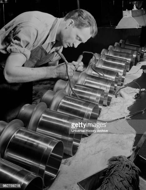 Worker Inspecting and Etching Cylinder Barrels for Airplane Engines at Manufacturing Plant Pratt Whitney East Hartford Connecticut USA Andreas...