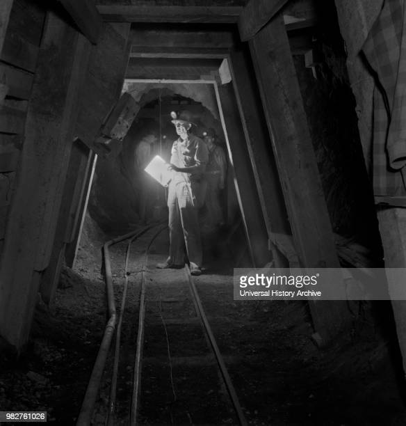 Worker Inspecting New Timbering in Mining Tunnel Quicksilver Mining Company New Idria California USA Andreas Feininger for Office of War Information...