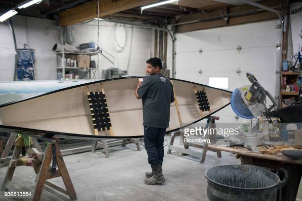 A worker inspects a completed canoe at the Holy Cow Canoe Co production facility in Guelph Ontario Canada on Thursday March 1 2018 Statistics Canada...