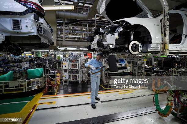 Worker inspects a Toyota Motor Corp Crown vehicle on the production line of the company's Motomachi factory on July 30, 2018 in Toyota, Japan. Toyota...