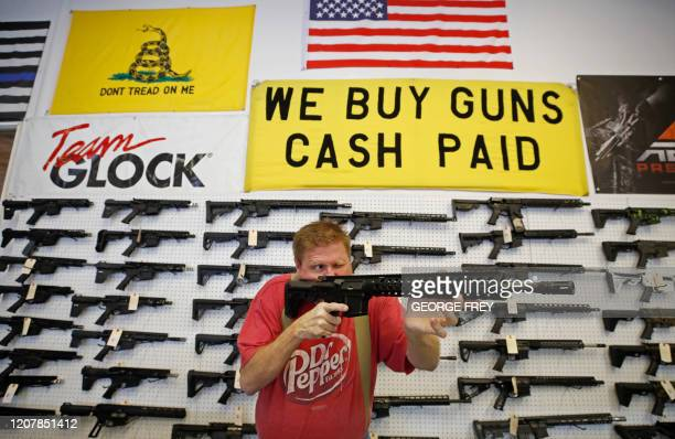 Worker inspects an AR-15 gun at Davidson Defense in Orem, Utah on March 20, 2020. - Gun stores in the US are reporting a surge in sales of firearms...