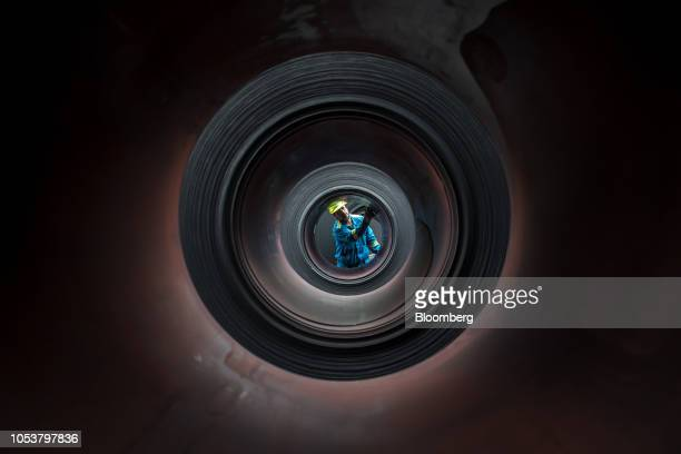 A worker inspects coils of steel in the storage yard at the ArcelorMittal Ostrava as plant in Ostrava Czech Republic on Friday Oct 19 2018 Liberty...