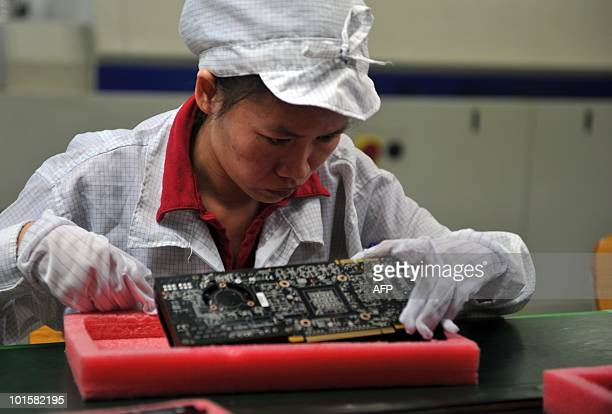 A worker inspects motherboards on a factory line at the Foxconn plant in Shenzen on May 26 2010 The Taiwanese boss of Apple manufacturer Foxconn...
