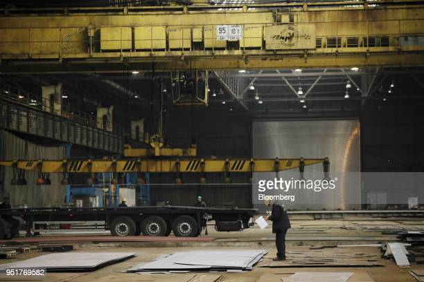 Worker inspects steel sheets on the factory floor at the GSG Towers Sp. Z o.o. Factory, a unit of the Gdansk Shipyard Group, in Gdansk, Poland, on...