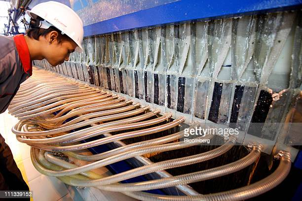 A worker inspects the filtration area during the opening of the PT Sinar Mas Agro Resources and Technology Tbk palm oil refinery in Marunda Indonesia...