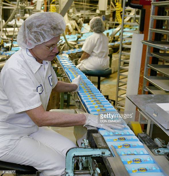 A worker inspects the packaging of Marshmallow Peeps at Just Born Inc in Bethlehem PA 29 March 2004 Just Born Inc a familyowned and operated...