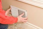 HVAC Worker Installing Residential Room Vent