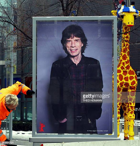 Worker installs a placard featuring Rolling Stones singer Mick Jagger at Potsdamer Platz in Berlin, on January 20 ahead of the 60th Berlin film...