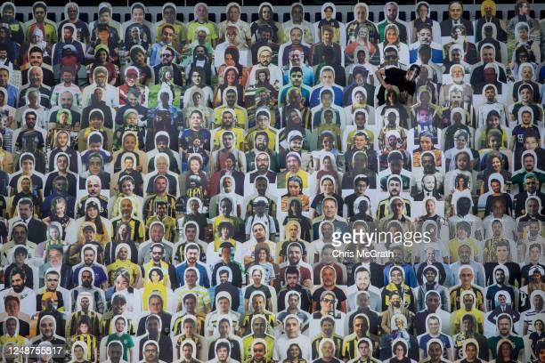 Worker installs cut-out portraits of Fenerbahce SK fans at Fenerbahce Sukru Saracoglu Stadium on June 10, 2020 in Istanbul, Turkey. Fenerbahce SK...