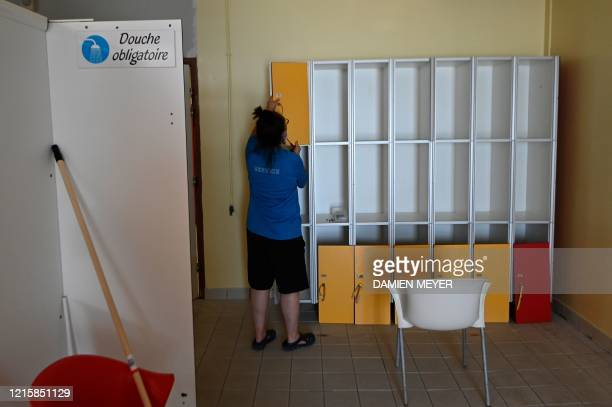 A worker installs lockers at the locker room of La conterie public swimming pool in ChartresdeBretagne suburbs of Rennes western France on May 28...