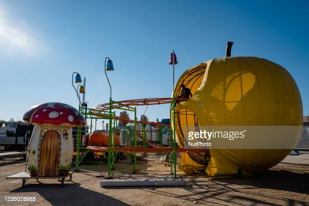 Worker installs the carousel at the Luna Park at Secca dei Pali in Molfetta, on 2 September 2021. On the occasion of the patronal feast of Our Lady...