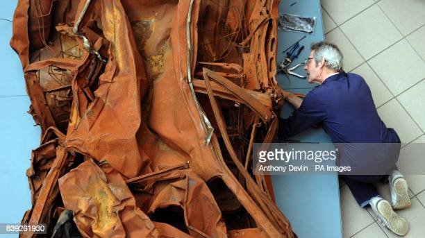 A worker installs Turner Prize winning artist Jeremy Deller's work titled Baghdad 5 March 2007 at the Imperial War Museum London The museum's new...
