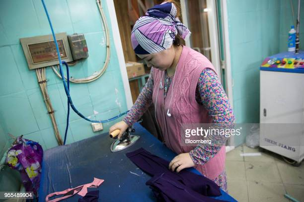A worker irons clothing at an Alinex garment factory in Bishkek Kyrgyzstan on Wednesday April 18 2018 The Kyrgyz Republic ranked 77th of 190...