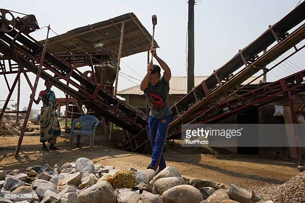 A worker is crashing stone by the heavy iron hammer in a Stone Crashing Plant in Sylhet Bangladesh A huge percentage of stone is being supplied to...