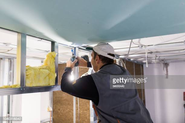 worker is fixing the drywall - foundation make up stock pictures, royalty-free photos & images