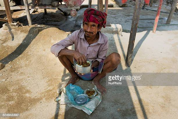 A worker is having his lunch with Ruti and Daal during a break in a Stone Crashing Plant in Sylhet Bangladesh A huge percentage of stone is being...