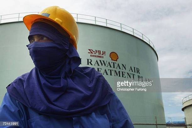 Worker is pictured at oil and gas processing facilities at Seria September 7 2004 in Brunei Brunei produces around 218000 barrels a day of crude oil...