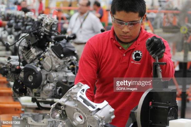 INC FACTORY QUERETARO MEXICO A worker is pictured during the manufacture of pieces for boats and planes at production plant 'Bombardier Inc' factory...
