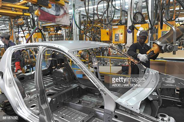 A worker is pictured in a DaciaSandero workshop in the Samoca factory in Casablanca on June 3 2009 The Dacia Sandero a subsidary of the Renault...