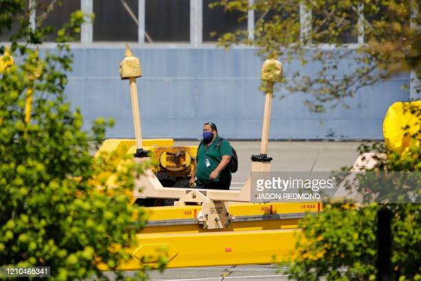 A worker is pictured walking at the Boeing Renton Factory where the Boeing 737 MAX airliners are built in Renton Washginton on April 20 2020 Boeing...