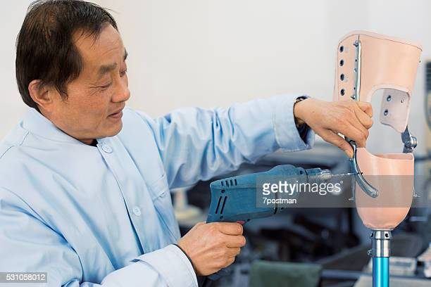 worker is Repairing a prosthetic