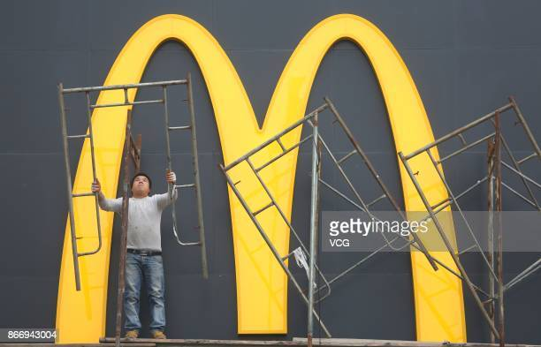 Worker is seen at a McDonald's restaurant under renovation on October 26, 2017 in Shengyang, China. McDonald's China has changed its company name...
