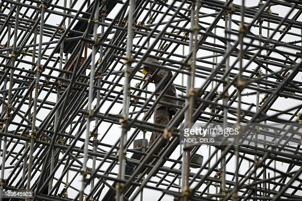 A worker is seen at a scaffolding at a construction site in Manila on May 30 2013 The Philippine economy posted a surprising 78 percent growth in the...