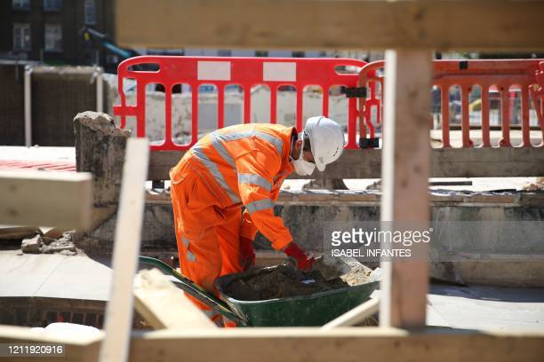 Worker is seen at work on the HS2 building site at Euston in London on May 6, 2020 as life continues under a nationwide lockdown imposed to slow the...