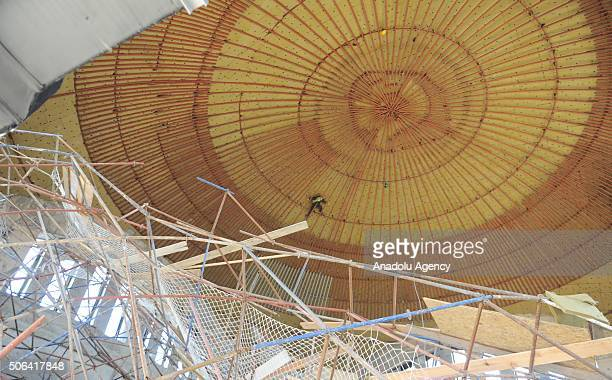 Worker is seen hanged on structural irons after a scaffolding collapse in a mosque construction in Turkey's Usak province on January 23, 2016. A...