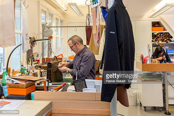 A worker is seen inside of the workshop for the special orders at the headquaters of the luxury brand Hermès rue Boissy d'Anglas in Paris