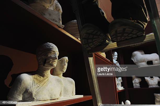 A worker is seen inside the Opera della Primaziale di Pisa before the opening of the Igor Mitoraj's exhibition on May 16 2014 in Pisa Italy The...