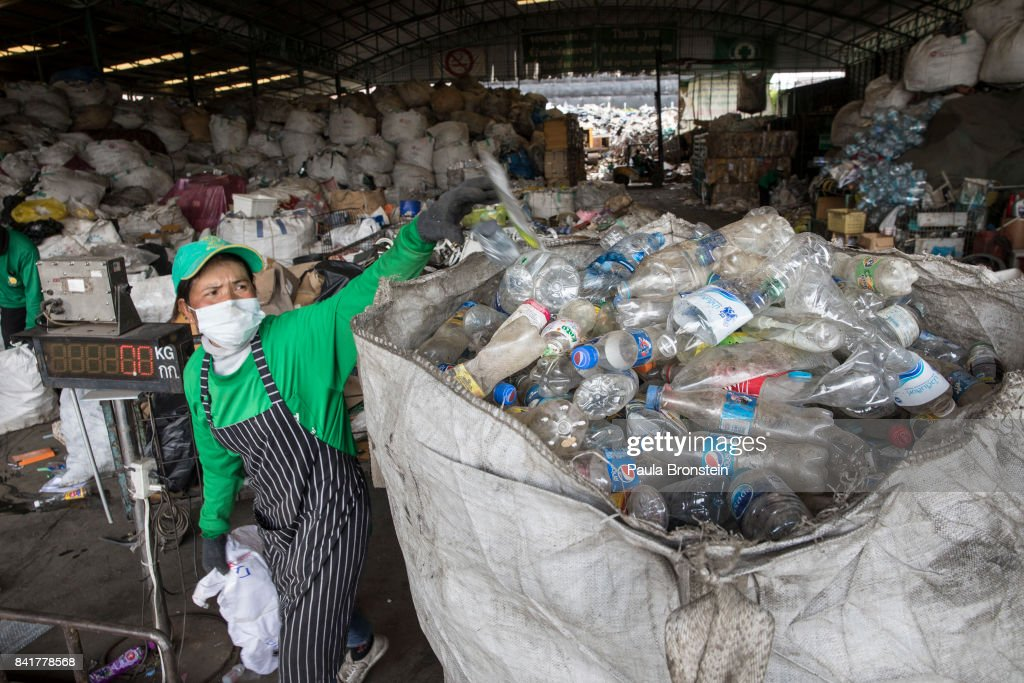 A worker is seen manually separating waste at the Wongpanit Suvarnabhumi recycle collection center on September 1, 2017 in Bangkok, Thailand. Plastic bottles can be recycled into Polyethylene Terephthalate (PET) bottle flakes and post consumer recycle (PCR) Resins and Fibers for the textile and Home furnishing market. Many plastic items like shopping bags, and food wrapping tend to be used for short periods before being discarded. A recent study stated that Thailand along with China, Indonesia, the Philippines and Vietnam are on the list of the world's top-five plastic polluters. Cleaning up plastic pollution in Thailand is a challenge due to cultural, infrastructure and environmental obstacles.