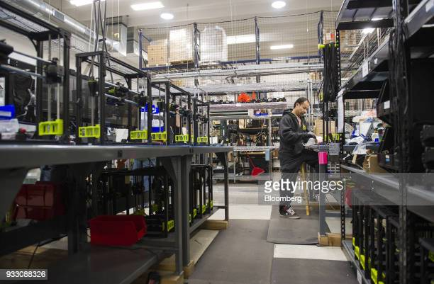 A worker is seen on the production floor at the Aleph Objects Inc LulzBot 3D printers production facility in Loveland Colorado US on Wednesday March...