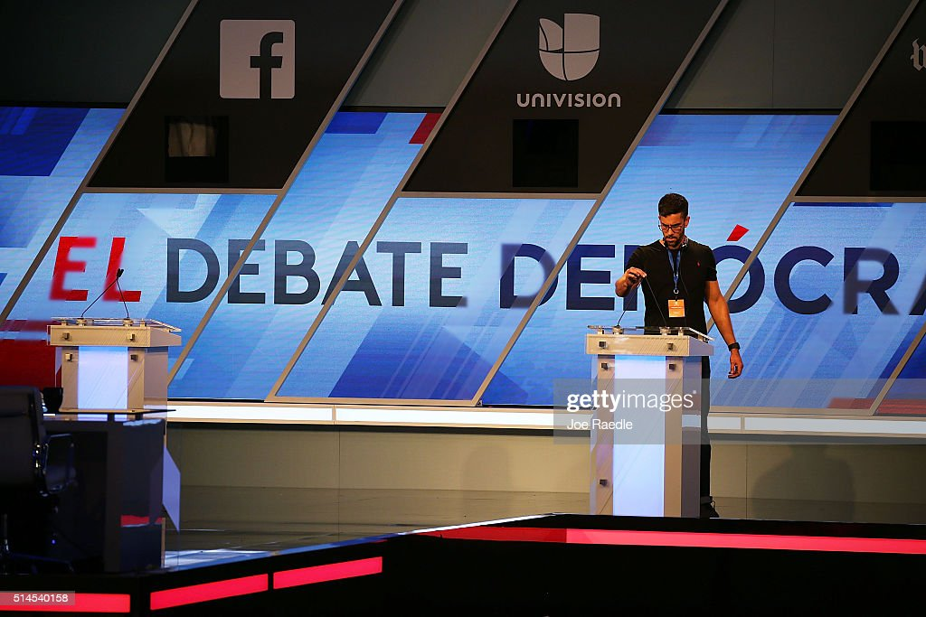 A worker is seen on the stage as it is prepared for the debate between Democratic presidential candidate Senator Bernie Sanders (D-VT) and Democratic presidential candidate Hillary Clinton at the Univision News and Washington Post Democratic Presidential Primary Debate on the Miami Dade College's Kendall Campus on March 9, 2016 in Kendall, Florida. Voters in Florida will go to the polls March 15th for the state's primary.
