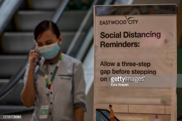 Worker is seen wearing a face mask at a mall on May 16, 2020 in Quezon city, Metro Manila, Philippines. The Philippine government began easing...