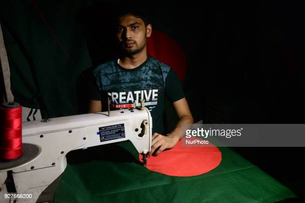 A worker is sewing the national flag of Bangladesh for upcoming event Independence Day on March 26 in Dhaka Bangladesh on March 05 2018